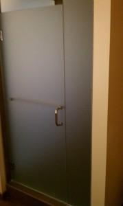 Shower doors going in at Inn at the 5th hotel in Eugene.