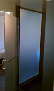 Shower doors going in at the Inn at the 5th hotel in Eugene.